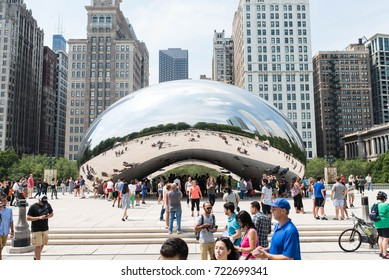 CHICAGO, ILLINOIS - AUGUST 19, 2017: Busy day at the Cloud Gate in Millennium Park Chicago, also known as the 'Chicago Bean'. Cloud Gate is a stainless steel sculpture by artist Anish Kapoor.