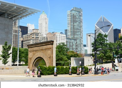 CHICAGO, ILLINOIS - AUGUST 22, 2015: Tourists ride Segways in Chicago. On Columbus Drive they pass in front of The Art Institute and Stock Exchange Building Arch.