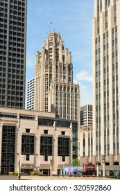CHICAGO, ILLINOIS - AUGUST 22, 2015: Tribune Tower. The Gothic style building is seen between some of the more modern architecture in Downtown Chicago.