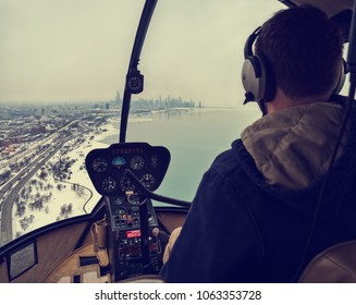 Chicago, Illinois, December 29, 2017. Helicopter pilot, flying over the city of Chicago, during a snowstorm