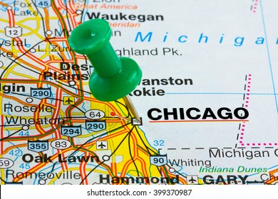 Chicago Illinois highlighted with push pin on atlas or map closeup