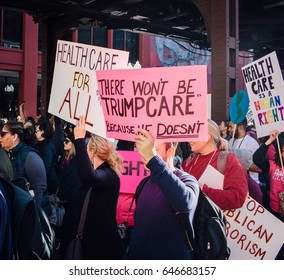 CHICAGO, ILLINOIS - JANUARY 21, 2017: [Signs advocating for healthcare at the Chicago Women's March]
