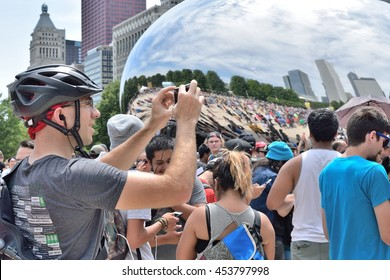 CHICAGO, ILLINOIS - JULY 17: Hundreds of Pokemon Go enthusiasts surround Millennium Park Bean sculpture for meetup signed up on Facebook on July 17, 2016 in near north side Millennium Park.