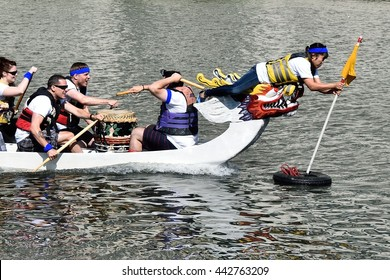 CHICAGO, ILLINOIS - JUNE 25: Goal flag is pulled on Dragon Boats on Chicago River South Branch for the Dragon Boat Race for Literacy on June 25, 2016 at Ping Tom Memorial Park in Chinatown.