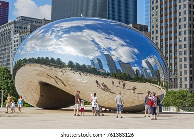 Chicago, Illinois - June 30th 2010: People looking at the reflection in the Chicago Cloud Gate, the Bean, sculpture.