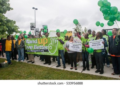 CHICAGO - ILLINOIS - JUNE 4, 2014:  Striking workers protest outside a Chicago Walmart store in the Chatham neighborhood.