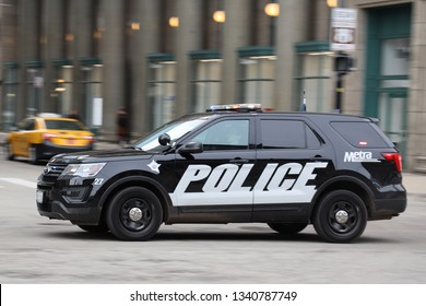 CHICAGO, ILLINOIS - MARCH 12, 2019: Chicago Metra Police car in motion in Downtown Chicago.The Metra Police Department was created to protect the 11 rail lines and 241 stations in metropolitan Chicago