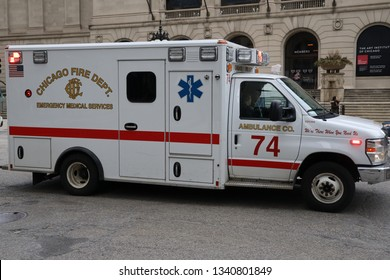 CHICAGO, ILLINOIS - MARCH 12, 2019:  Chicago Fire Department Ambulance in Downtown. The Chicago Fire Department (CFD) provides fire suppression and emergency medical services to the city of Chicago