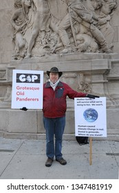 CHICAGO, ILLINOIS - MARCH 12, 2019: Unidentified man protests against GOP and support global warming effect in downtown Chicago