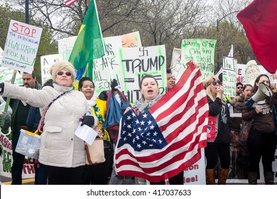 CHICAGO, ILLINOIS - MAY 1, 2016: Hundreds of marchers turned up on May Day to unite around a protest of Trump on the right wing agenda against all workers and immigrants.