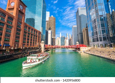 CHICAGO, ILLINOIS -  MAY 10, 2019:  A river tour passes on the Chicago river.