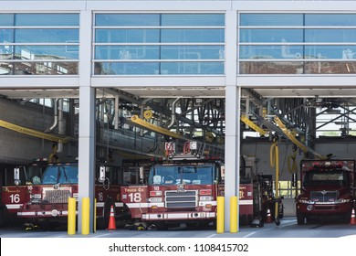 CHICAGO, ILLINOIS - May 19,2018 : Fire department or dept. firehouse with truck or rescue car. Building or construction station for firefighter.