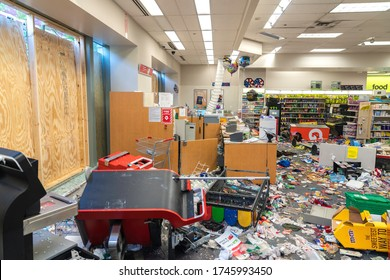 CHICAGO, ILLINOIS - MAY 31, 2020: CVS Pharmacy store interior destroyed by the protesters after nights of riots, looting and chaos in Downtown Chicago. Broken windows and debris on the floor