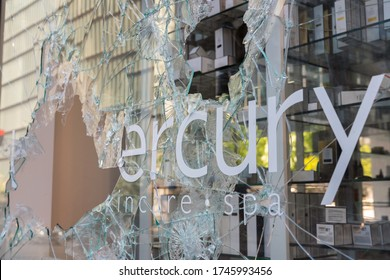 CHICAGO, ILLINOIS - MAY 31, 2020: Broken window storefront after protesters march demonstrations against police in Chicago