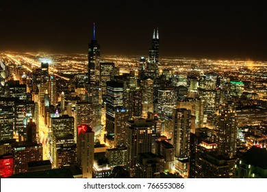 Chicago, Illinois at night as seen from above.