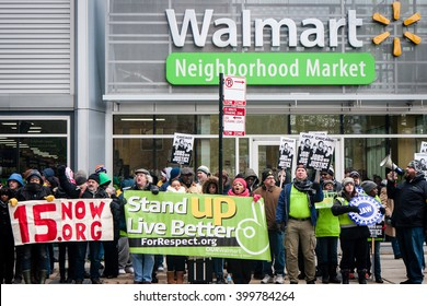 CHICAGO, ILLINOIS - NOVEMBER 28, 2014: Striking Walmart workers and supporters protest against low wages and charge that Walmart retaliates against employees who push for better working conditions.