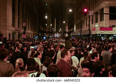 CHICAGO, ILLINOIS - NOVEMBER 4, 2008: Crowds celebrate in the streets near Grant Park as Barack Obama wins the presidency of the United States.