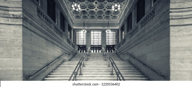 CHICAGO, ILLINOIS - OCTOBER 13: One of two grand staircases inside Union Station on October 13, 2018 in Chicago, Illinois