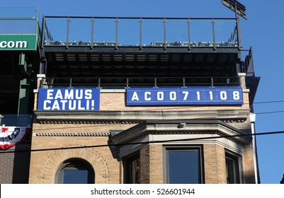 "Chicago, Illinois - October 23, 2016: Eamus Catuli sign on a building by Wrigley Field. Latin for, ""Let's go Cubs,"" numbers are 0071108 after the 2016 Cubs National League Championship Series  win."
