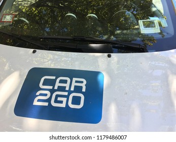 CHICAGO, ILLINOIS - SEPTEMBER 14, 2018: Close up view CAR2GO shared ride vehicle parked in shade on Green Street near West Grand Avenue Fulton market district.