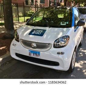 CHICAGO, ILLINOIS - SEPTEMBER 14, 2018: CAR2GO hourly share vehicle parked in shade on N Green Street at West Grand Avenue, Ukrainian Village neighborhood.