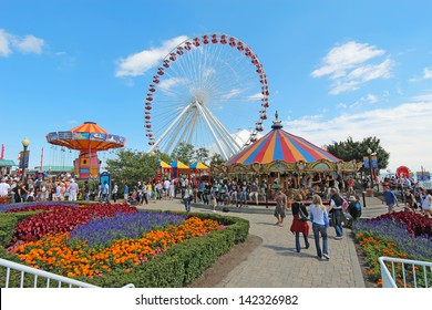 CHICAGO, ILLINOIS - SEPTEMBER 4: Tourists at the amusement park on Navy Pier in Chicago, Illinois on September 4, 2011. The Pier is a popular destination with many attractions on Lake Michigan.