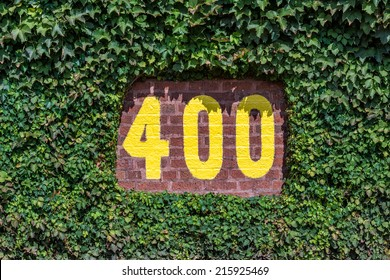 CHICAGO, ILLINOIS - SEPTEMBER 8: 400 feet sign on the outfield wall of Wrigley Field on September 8, 2014 in Chicago, Illinois