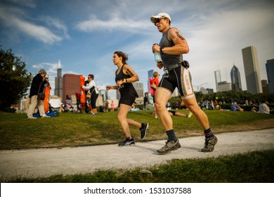 CHICAGO, ILLINOIS / UNITED STATES - 25 AUGUST 2019: Steve Wesselhoff (R) and Biana Modilevsky compete in the run portion of the Chicago Triathlon.