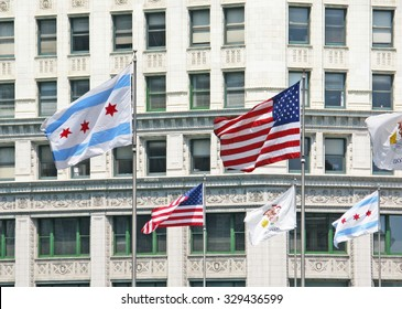CHICAGO, ILLINOIS, UNITED STATES - JULY 29, 2008: American, Illinois and Chicago flags outside the Wrigley building on July 29, 2008 in Chicago, United States.