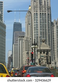 CHICAGO, ILLINOIS, UNITED STATES - JULY 26, 2008: Urban scene with traffic and the Hancock building on Lake Shore Drive on July 26, 2008 in Chicago, United States.