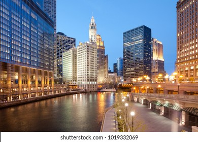 Chicago, Illinois, United States - May 04, 2011: A view of Chicago River, riverwalk and office buildings at downtown.