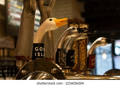 Chicago, Illinois, United States - October 7, 2018: Goose Island beer tab handles at Goose Island Beer Company tasting room located on 1800 W Fulton Street.