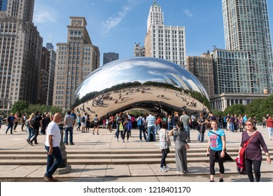 Chicago, Illinois, United States - October 9, 2018: Cloud Gate, a public sculpture designed by Sir Anish Kapoor, which is the centerpiece of AT&T plaza at Millennium Park.