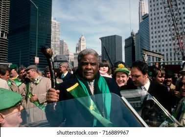 Chicago Illinois, USA, 17th March, 1987 Chicago Mayor Harold Washington shakes his shillelagh during the annual St. Patricks day parade on streets of the downtown Loop area of the WIndy City