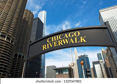 Chicago, Illinois, USA 27.06.2015: Chicago Riverwalk sign with skyline in background. Chicago Riverwalk is the famous pedestrian waterfront along Chicago River