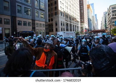 Chicago, Illinois / USA -5/30/2020: Protest for George Floyd, A man tries to divert protestors from police.