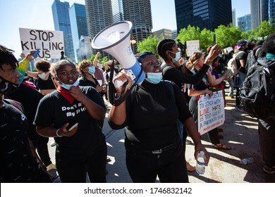 Chicago, Illinois / USA -5/30/2020: Protest for George Floyd, A person talks on a megaphone in a crowd.