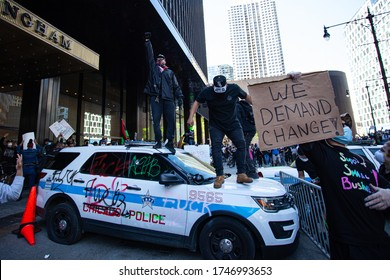 Chicago, Illinois / USA -5/30/2020: Protest for George Floyd, A man stands on top of a police car