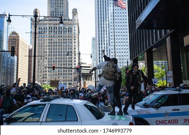 Chicago, Illinois / USA -5/30/2020: Protest for George Floyd, People stomp on police cars.