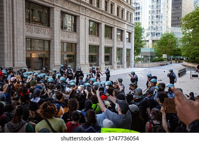 Chicago, Illinois / USA -5/30/2020: Protest for George Floyd, protesters clash with police in tense confrontation.