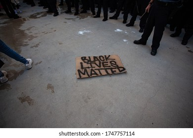 Chicago, Illinois / USA -5/30/2020: Protest for George Floyd, A protest sign on the ground.