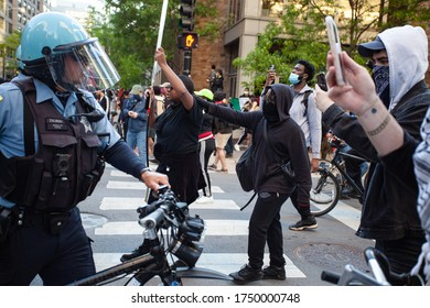 Chicago, Illinois / USA -5/30/2020: Protest for George Floyd, protesters clash with police during peaceful protest in a march for justice for George Floyd.