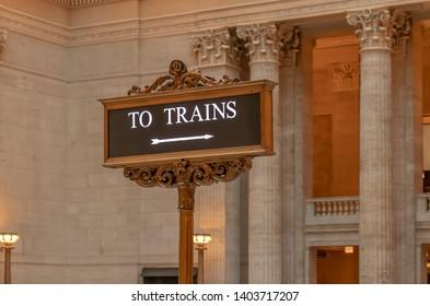 Chicago, Illinois, USA - 9 April 2019.  A decorative sign directing passengers to train platforms inside Chicago Union Station, Illinois, USA.