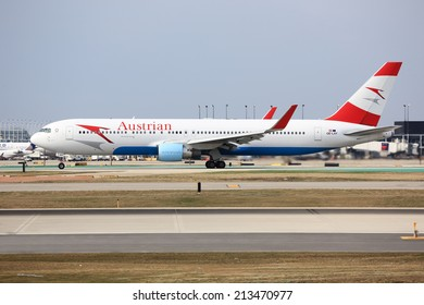 Chicago, Illinois, USA - April 12, 2014: Vienna-bound Austrian Airlines Boeing 767 on its take-off roll from Chicago O'Hare International Airport (ORD).