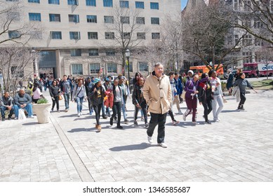 Chicago, Illinois / USA - April 20,2018: Students, faculty and citizens protest against gun violence and Chicago Mayor Rahm Emanuel on the University of Chicago Campus.