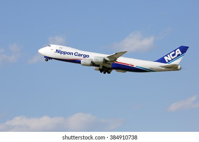 Chicago, Illinois, USA - April 4, 2015 - Nippon Cargo (NCA) Boeing 747 cargo aircraft taking off from runway 28R at Chicago O'Hare International. This is a new generation Boeing 747-8 freighter.