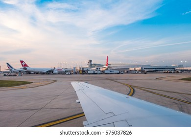 Chicago, Illinois, USA - Aug 9, 2016: commercial Jet aircraft docked at Chicago o'hare airport preparing for take off during sunset.