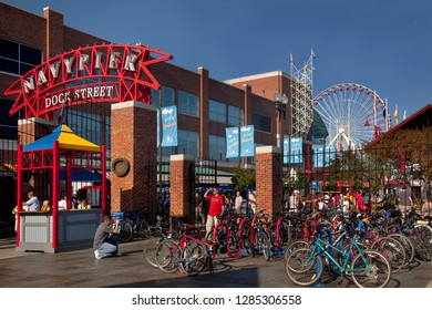 Chicago, Illinois, USA – August 02, 2009: Horizontal shot of the visitors of the colorful Navy Pier on a summer day, taking photos at an entrance plenty of parked bicycles, before its last remodeling