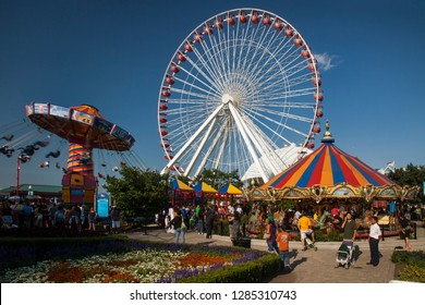 Chicago, Illinois, USA – August 02, 2009: Horizontal shot of the colorful Navy Pier amusement park, with the retro Ferris wheel and carousel, on a beautiful summer day before its last remodeling