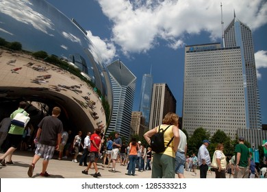 Chicago, Illinois, USA – August 02, 2009: Horizontal view of the Millenium Park visitors on a sunny summer day close to Anish Kapoor Cloud Gate (The Bean) sculpture with a Chicago skyline background